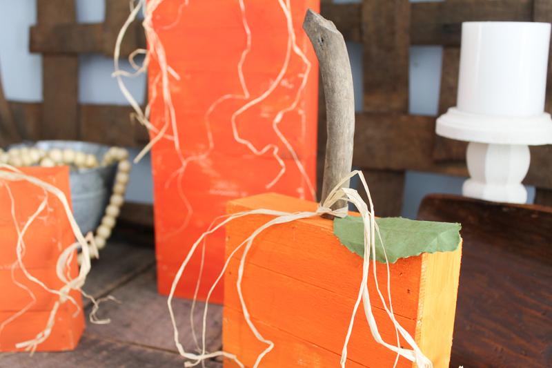 driftwood stems on rustic wood pumpkins