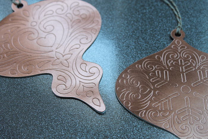 Make these paper Christmas ornaments with your Cricut machine and add them to your tree! Embossed details are easy to make with the scoring wheel! #cricut #cricutmade
