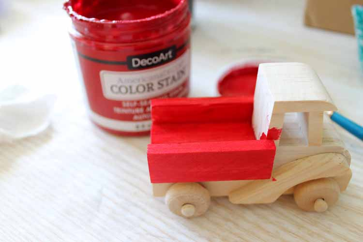 Make this red truck with Christmas tree ornament for your Christmas decor! A great addition to any farmhouse style tree! #christmas #christmasornaments #farmhousestyle