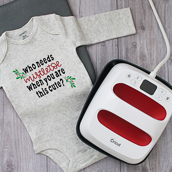 Make this baby Christmas outfit with your Cricut and Cricut EasyPress! A cute mistletoe onesie that will look great on baby! Includes the cut file! #cricut #cricutmade #onesie