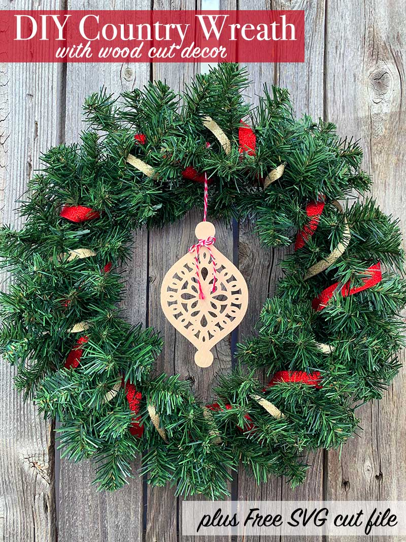 DIY Country Wreath for Christmas with wood cutout made on the Cricut Maker.  #cricut #cricutmade