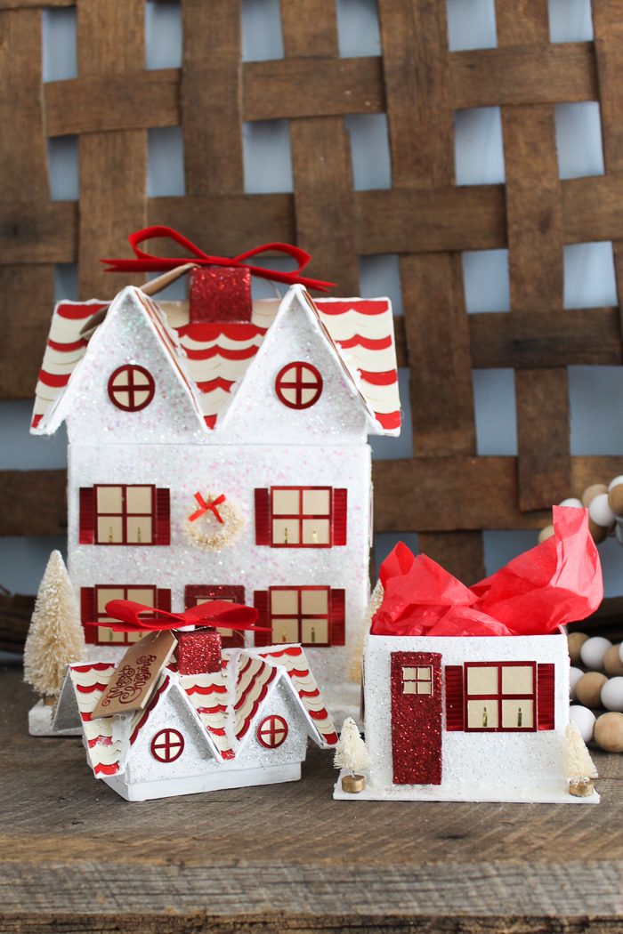Learn how to make a gift box with your Cricut machine! A great way to wrap those Christmas gifts! A Christmas house makes a great gift wrap idea! #cricut #cricutmade