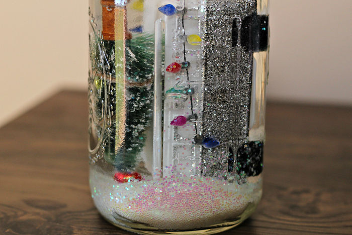 adding water to a mason jar snow globe