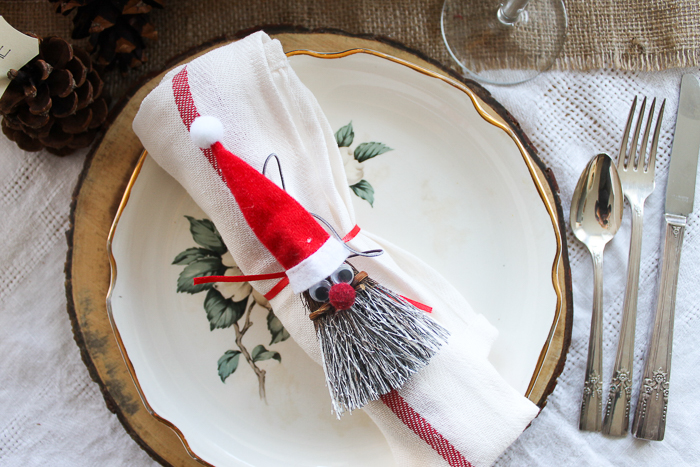 broom santa on a Christmas tablescape