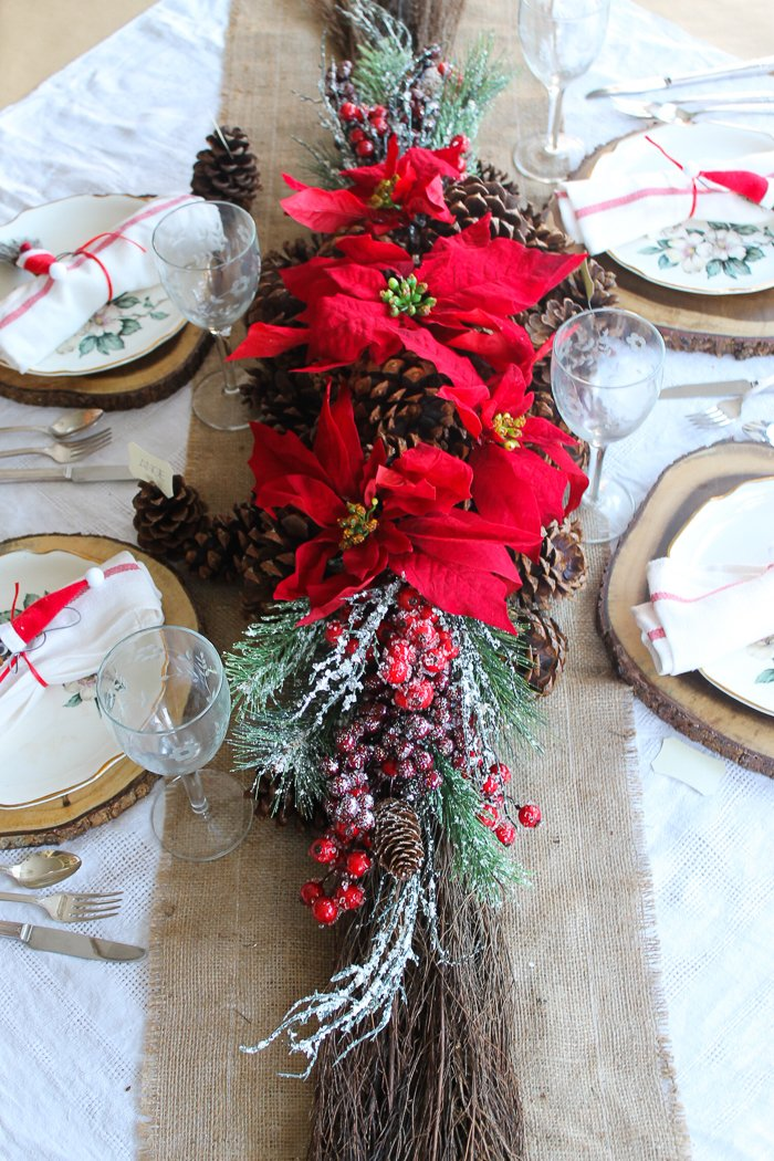poinsettia and pine cone christmas centerpiece