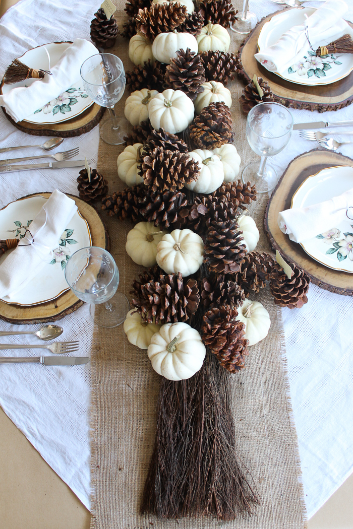 pinecones and pumpkins on a fall table