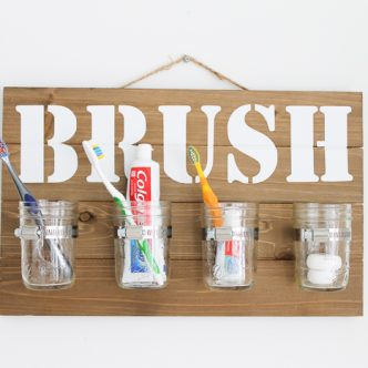 mason jar wall decor to organize a bathroom
