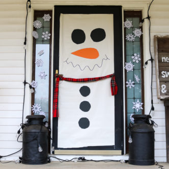 Make these snowman door decorations in just minutes then add color changing lights! The same decoration will work for Christmas and winter! #snowman #christmas #winter