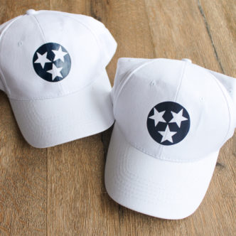 Learn about adding heat transfer vinyl to hats. Post compares three methods including a heat press, EasyPress, and mini iron! #cricut #cricutmade #htv #heattransfervinyl #hats