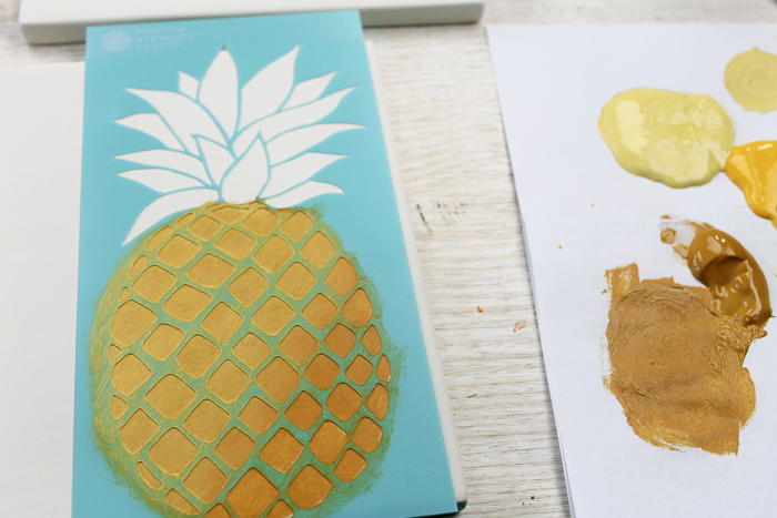 Painting on tile to make ceramic trivets.