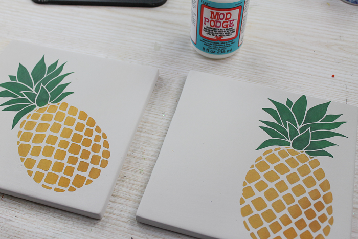 Using dishwasher safe mod podge on painted tile trivets.