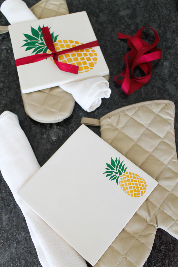 Make a ceramic trivet from a tile and then add some painted pineapples! A cute gift idea or fun addition to your kitchen! #kitchen #trivet #painting