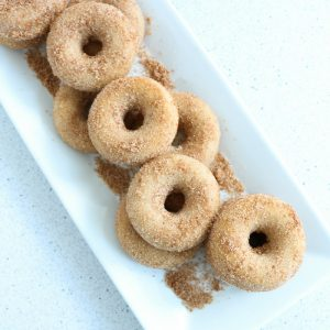 Whip up a batch of cinnamon sugar donuts with this baked recipe! #donuts #cinnamon #recipe