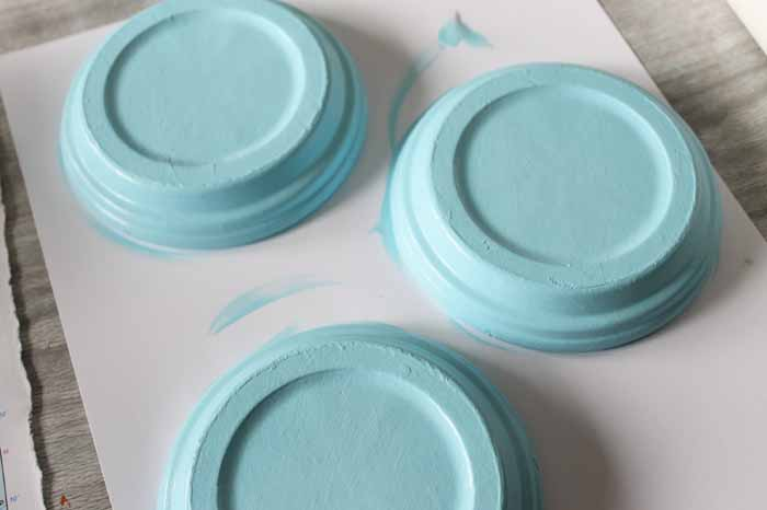 Painting terra cotta saucers to make coasters.