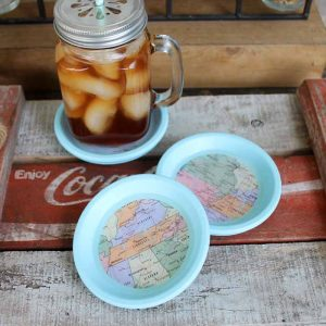 A simple tutorial for how to make coasters with maps and resin! Turn terra cotta saucers into the best coasters for your home! #coasters #maps #resin #crafts