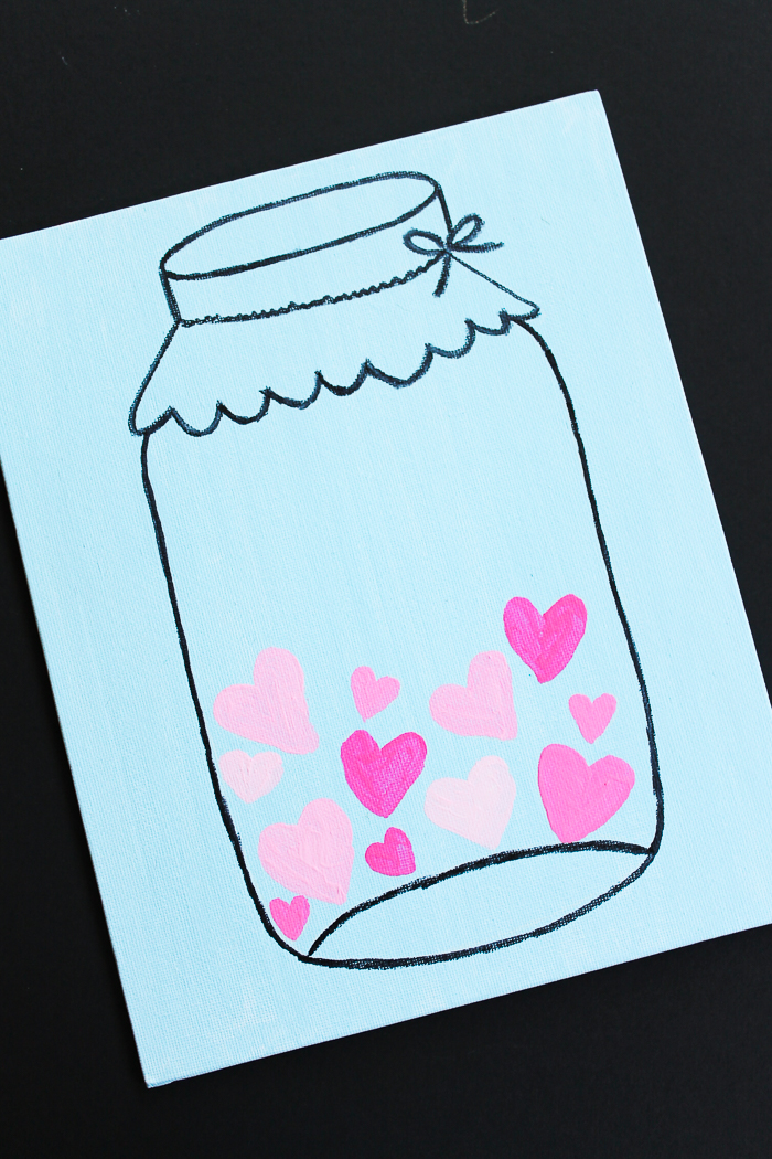 Paint a mason jar picture on canvas for Valentine's Day! Use a template and this easy method to create your own mason jar art in minutes! #masonjar #valentinesday