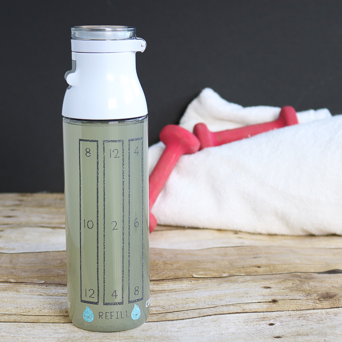 Use the Cricut BrightPad to weed glitter vinyl and add it to a water bottle! A great way to keep track of how much water you drink and stay healthy!