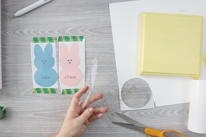 Make DIY gift ideas for grandmas with a Cricut. Applying transfer tape to peeps bunnies cut from vinyl.