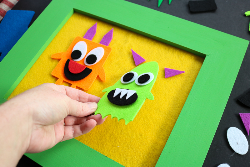 A felt story board with monsters cut with the Cricut machine. Includes a free monster SVG file to cut using your Cricut or Silhouette!