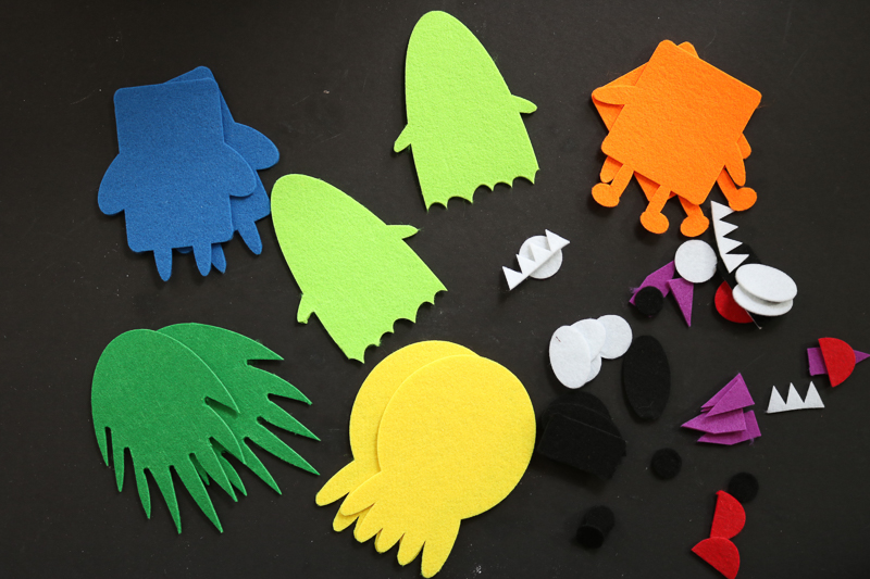 Making a felt board for stories monster pieces cut from felt with a free SVG file and a Cricut or Silhouette machine.