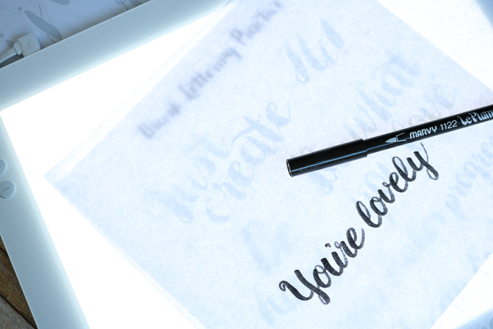 Using a marker to trace hand lettering with the Cricut BrightPad