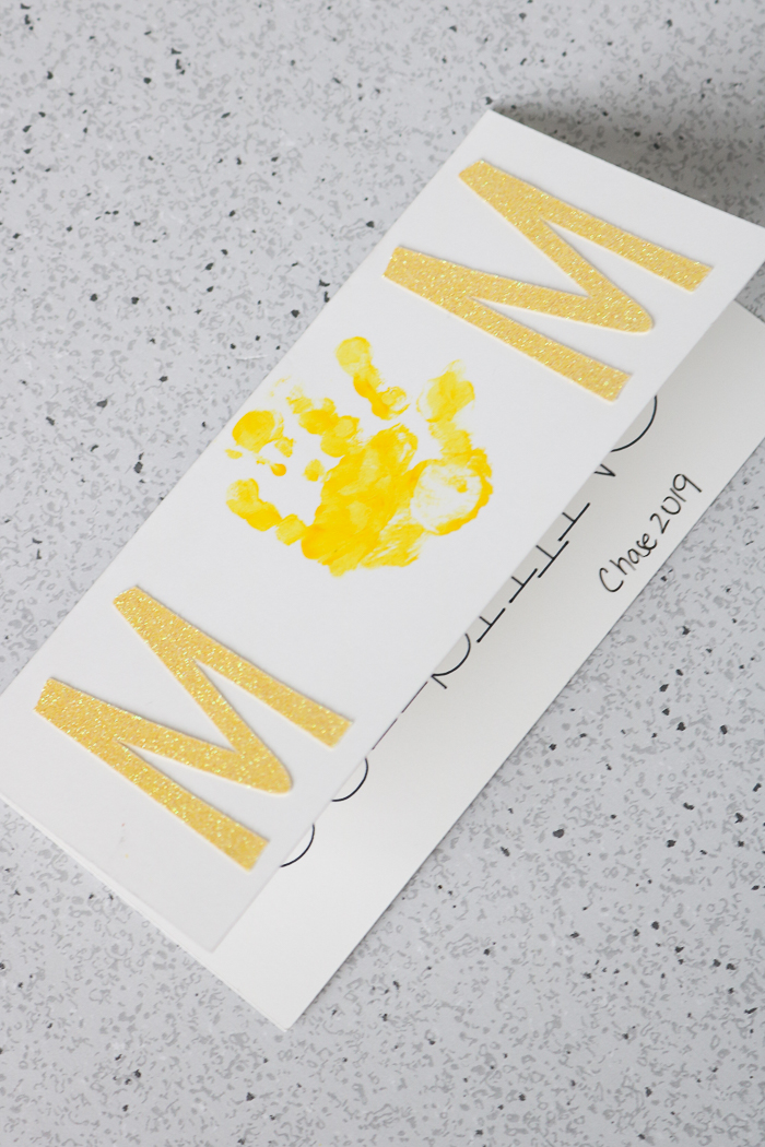How to make a Mother's Day card with your toddler and your Cricut machine.