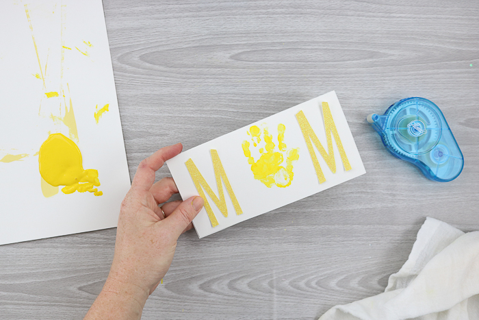 Make your own Mother's Day card with a handprint.