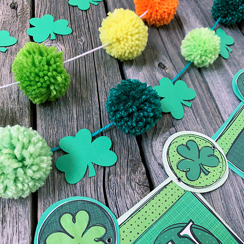DIY pom pom garland that is perfect for Saint Patrick's Day