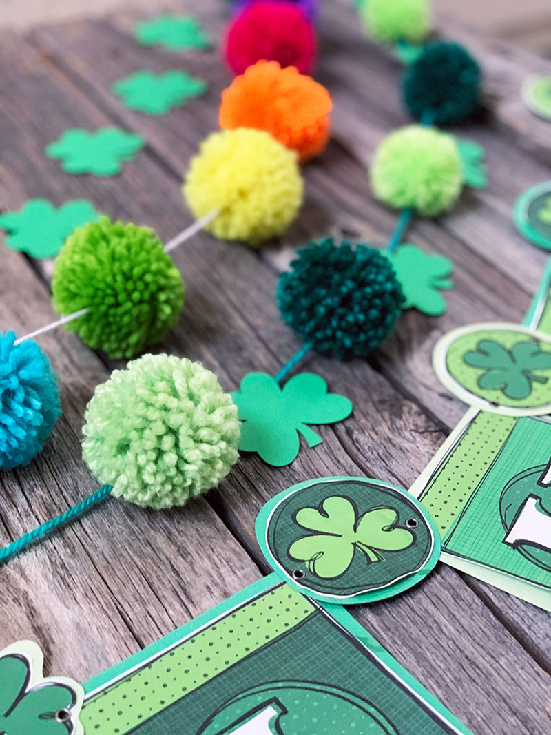 Make some Saint Patrick's Day decor with this DIY pom pom garland tutorial!