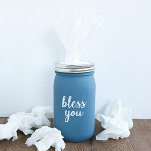 This tissue holder mason jar is an easy craft project that anyone can make for their home with a few supplies! Add art to the front with your Cricut machine if you would like!