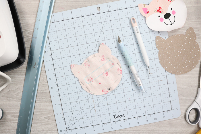 Use Cricut hand tools to make cuts in fabric.