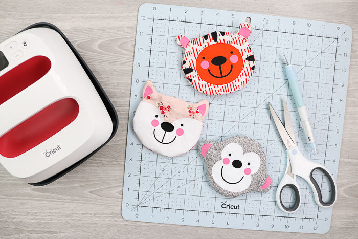 Animal faced zipper pouches with a fox, monkey, and tiger shape. All Cricut projects you can make with the Cricut Maker.