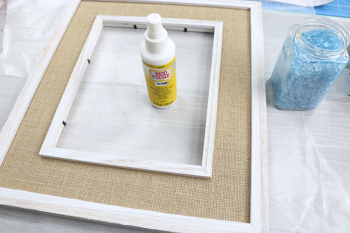 Using Mod Podge Ultra to adhere glass to a surface.
