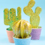 A DIY cactus from paper mache with glitter paint and a decoupage twine pot.