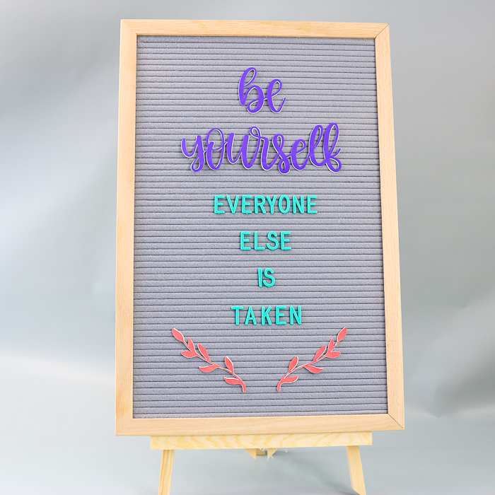 Quote on a letter board with DIY letter board accessories made with a Cricut machine