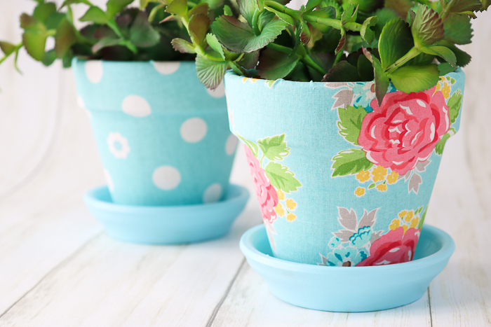 Decorating plant pots with fabric using Mod Podge Ultra.