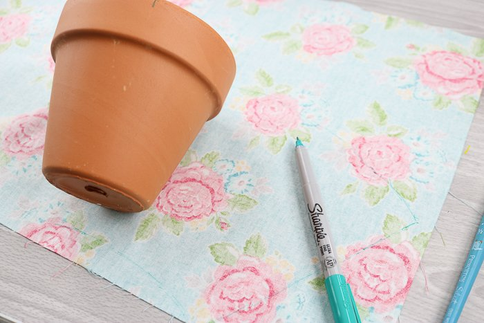 Tracing a planter pot onto colorful fabric