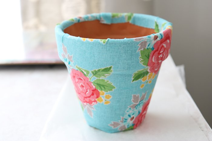 DIY fabric plant pots drying after using Mod Podge Ultra.