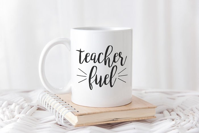 "A free teacher SVG with ""teacher fuel"" on a coffee mug"