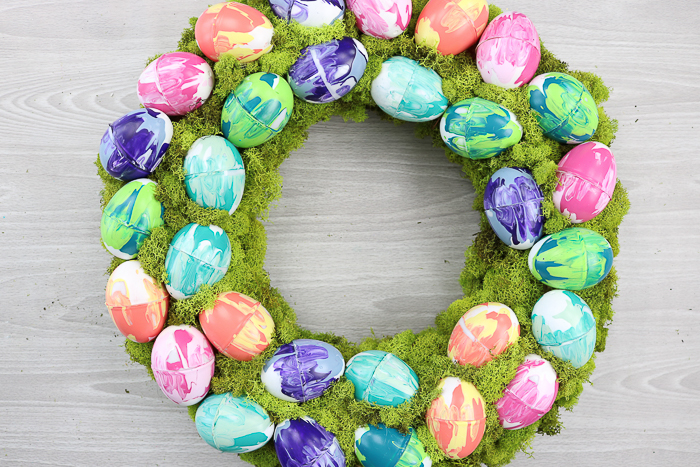 Moss covered spring wreath with marbled Easter eggs.