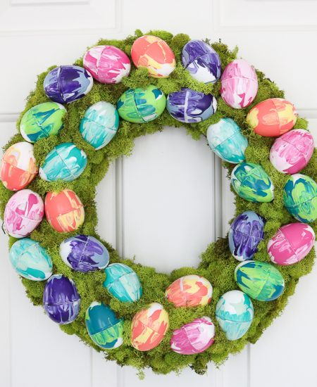 Easter wreath with moss and marbled eggs.