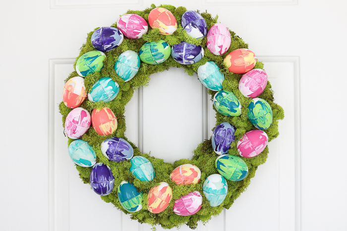 Marbled Easter eggs on a moss covered wreath.