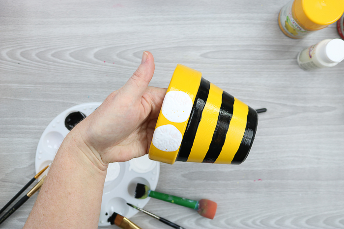 Ideas for flower pot decoration including how to paint a flower pot to look like a bee.