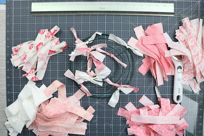 How to tie on fabric strips to a wire wreath form to make a rag wreath