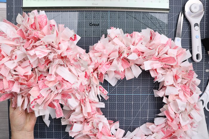 Two completed rag wreaths