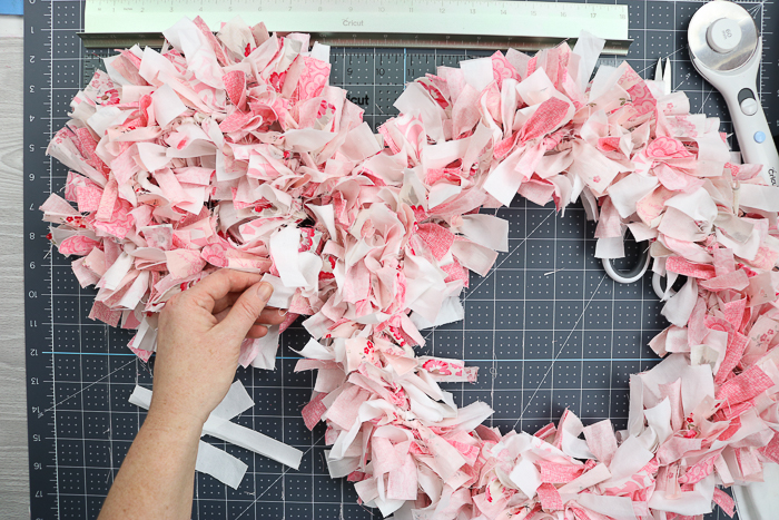 Tie two rag wreaths together to make an Easter bunny wreath.