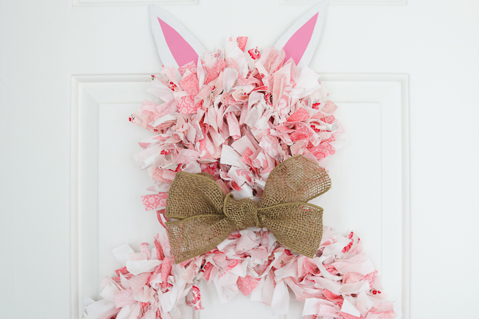 Rag wreath shaped like an Easter bunny that includes a step-by-step tutorial for using Cricut Hand tools to make this cute wreath!