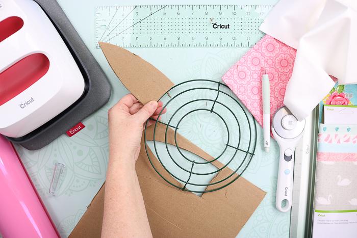 Making cardboard ears for a bunny rag wreath