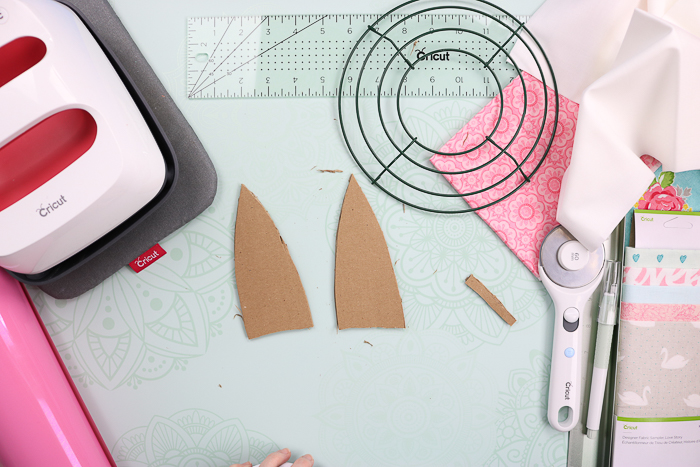 Cutting cardboard ears for a bunny wreath