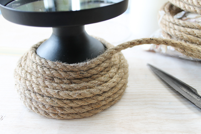 diy beach bathroom decor using rope to wrap around a candle holder